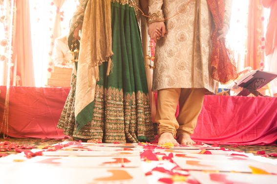 Whimsical Hindu wedding with Indian bride in a green lehnga and groom in white sherwani | Kumari Photo | Rubies and RIbbon  http://kumariphotoanddesign.com/